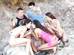 Insane damsels plow on the beach